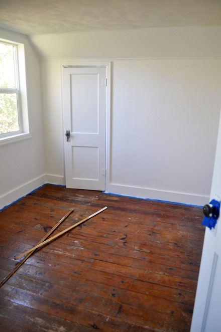 white walls and pine floors
